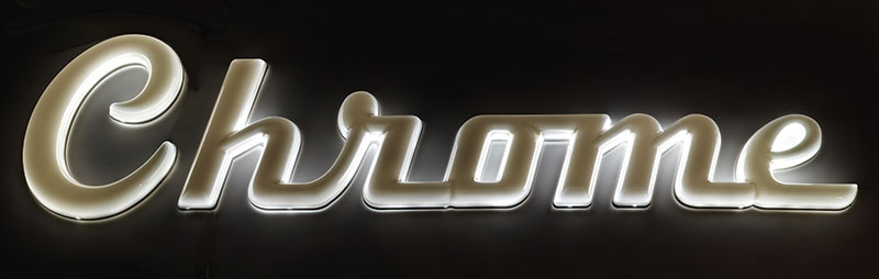 Lighted chrome plastic letters at night