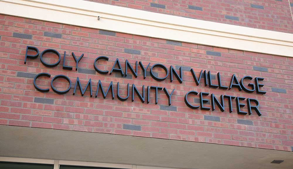 Cast Aluminum, Painted black ribbon deep letters at Poly Canyon Village