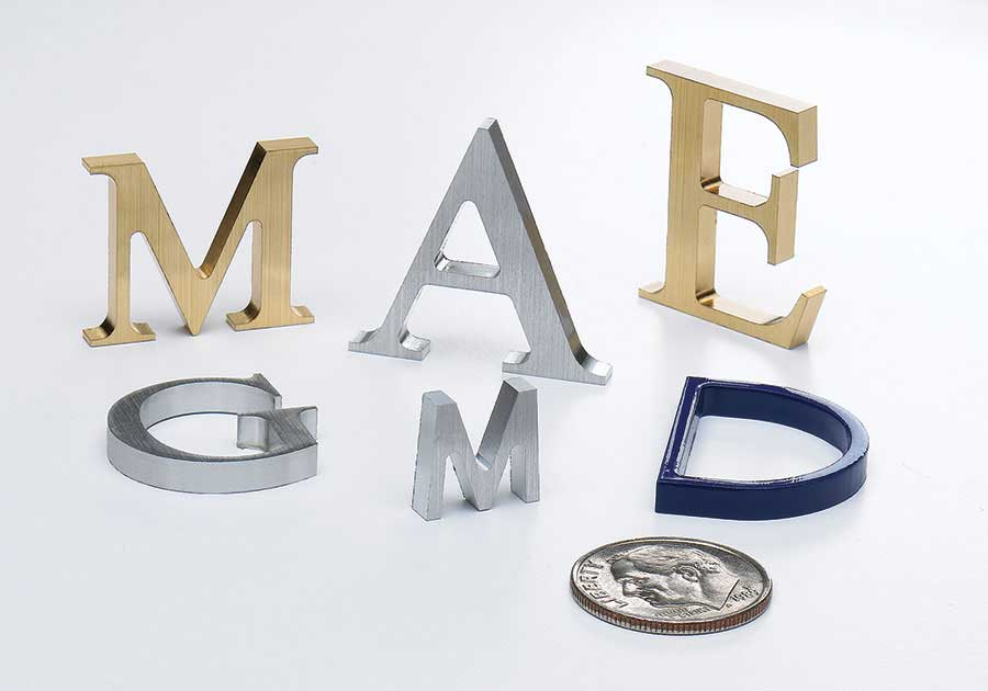 Mini metal letters shown on a large doner wall display