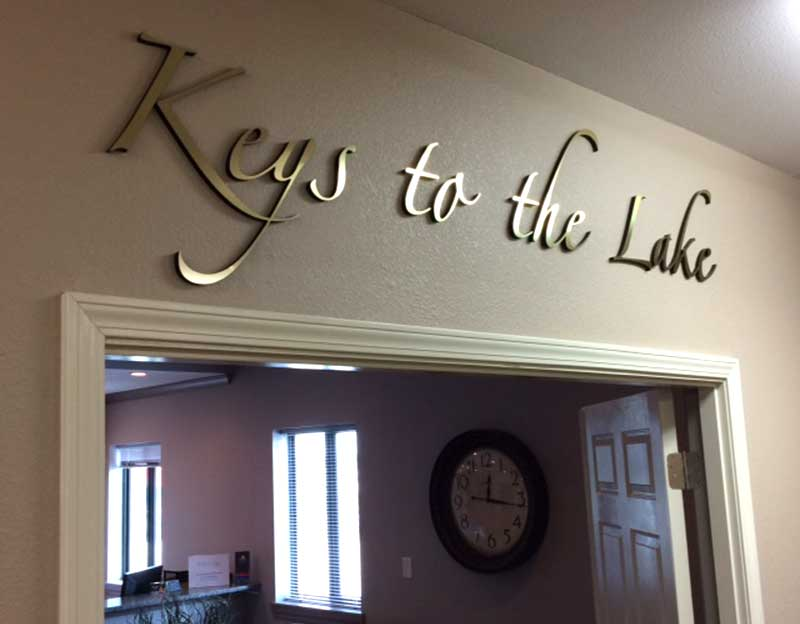 Keys to the Lake office metal laminated brass on black acrylic