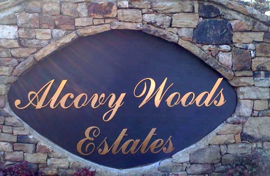 alcovy-woods estates in Bronze cut letters
